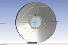 Рис. 4. Эскиз, описывающий спираль и переводной канал (а) и обрезка твердотельной модели заготовки с помощью полученного эскиза (б)