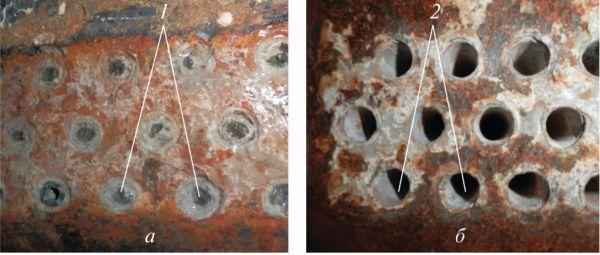 Рис. 6. Трубная решетка воздухоохладителя компрессора без водоподготовки (а) и при ее наличии (б): 1 – трубки с рыхлой накипью; 2 – абсолютно чистые трубки