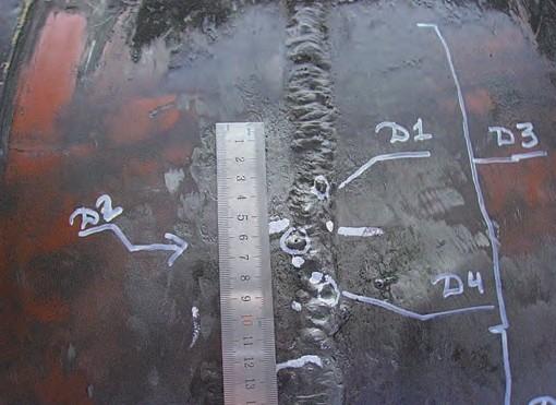 Рис. 5. Вид маркированной области выявленного дефекта кольцевого сварного соединения магистрального нефтепровода в результате расширенного обследования в шурфах по данным проведенной внутритрубной дефектоскопии